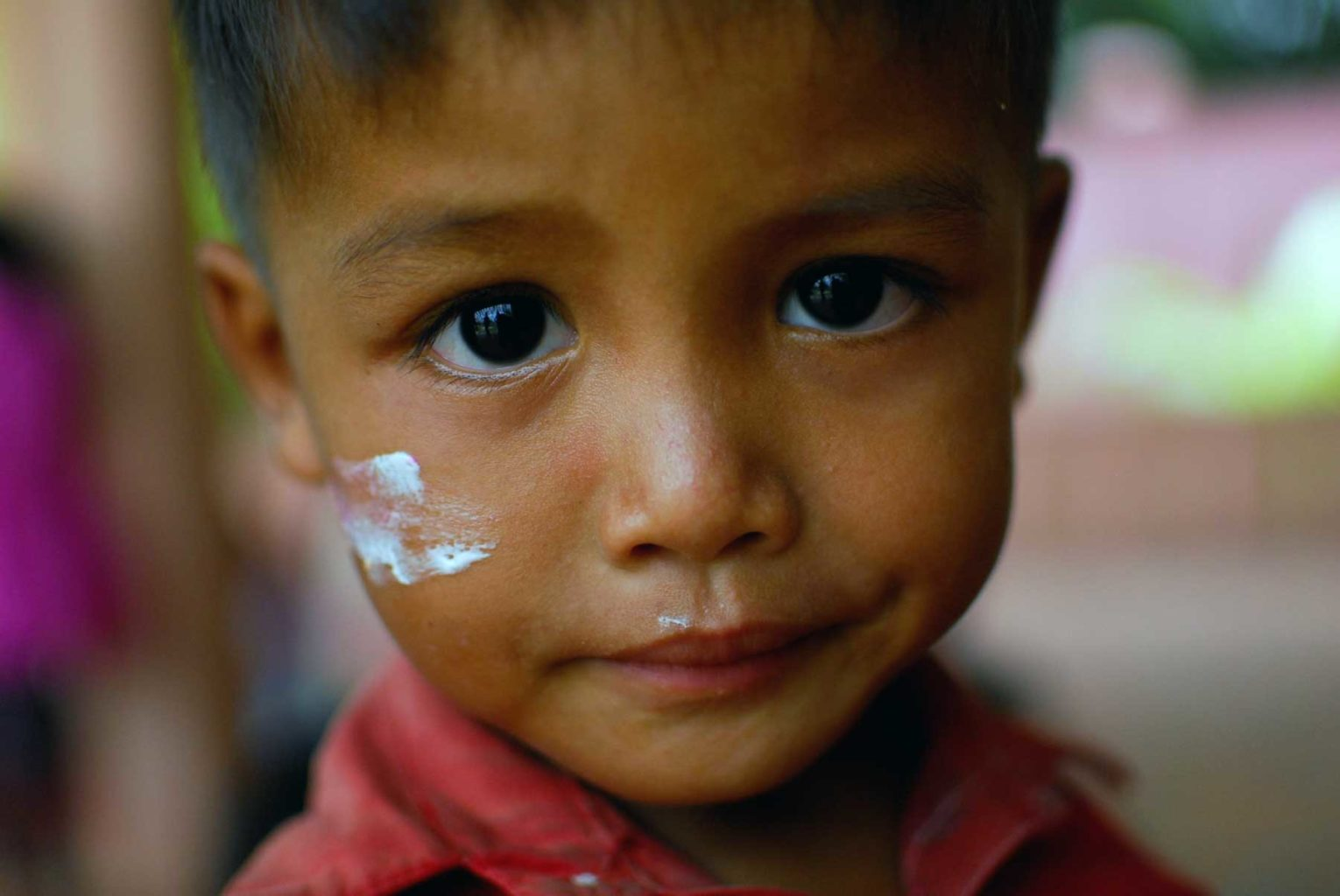 Little boy sponsoring child Cambodia orphans orphans of child abuse beautiful sad eyes humanitarian