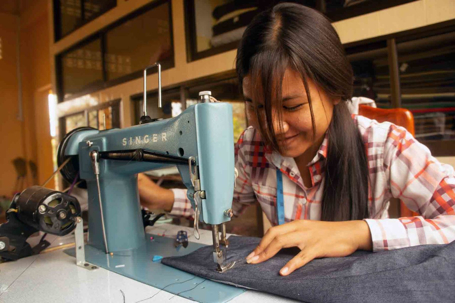 Young Cambodian girl following an apprenticeship in sewing design in a training center in Battambang, Cambodia.